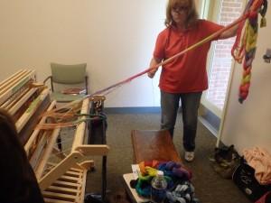 Linda wrangles her warps.